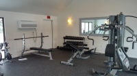 Corporate housing with on premise fitness centers